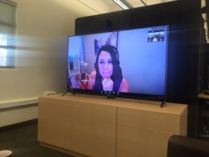An image showing Michelle's video presence projected on a large monitor.